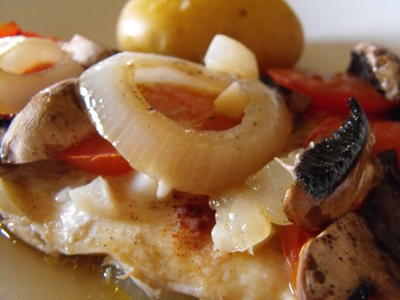 fish fillet with tomatoes and mushrooms