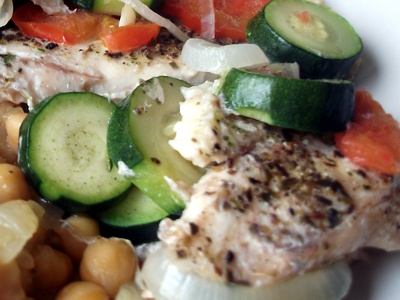 fish fillet with zucchini and tomatoes