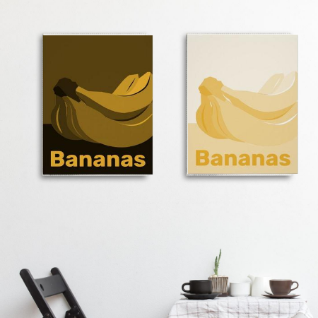 a black and white dining area showing as wall decor monochrome canvas prints in hues of yellow with bananas