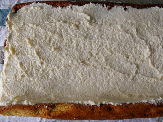 Step 6: When the rolled caked cooled completely, spread the cream cheese coconut filling evenly.