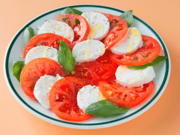 tomato and mozzarella salad, arranged on a plate