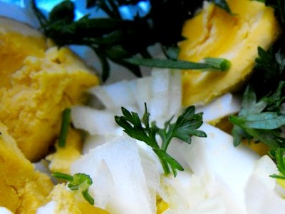 Step 2 - Dice eggs, onions and chop the parsley, put together in one bowl