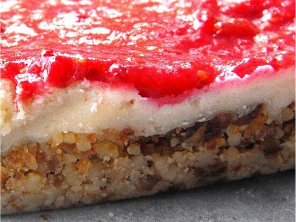 close-up, slice of three layered raspberry nut cake